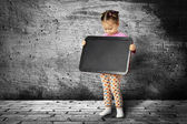 The small child with a board for drawing — Stock Photo
