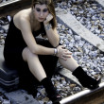 Beautiful woman with black dress — Stock Photo