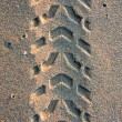 Stok fotoğraf: Tire tracks on the sand