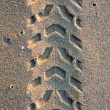 Tire tracks on the sand — Stock fotografie