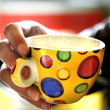 Man holding a cup of tea - Stockfoto