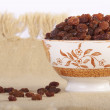 Bowl of raisins — Stock Photo