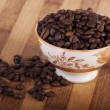 Beans of coffee on a bowl — Stock Photo