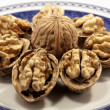 Walnuts on a plate — Stock Photo