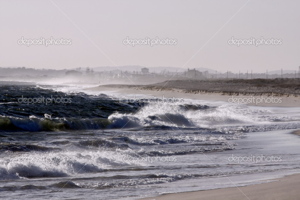 Violent and windy day at Faro beach on Portugal. — Stock Photo #5246881