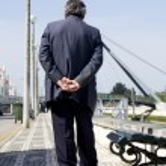 Lonely man walks on street — Stock Photo #5263733