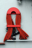 Fire hose on boat — Stock Photo