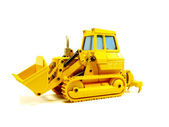 Miniature construction scraper — Stock Photo
