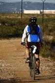Man riding a bike — Stock Photo