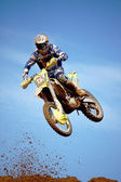 Motocross dirtbike in the air — Stock Photo
