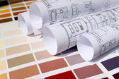 Blueprint of home with background of paint color palette — Stock Photo