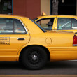 Stock Photo: Cabs in city