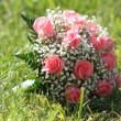 Flowers bouquet in grass — Stock Photo