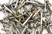 Galvanized screws on white — Stock Photo