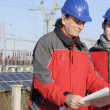 Engineer in a solar panel station — Stock Photo