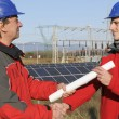 Engineer in a solar panel station — Stock Photo #5255261
