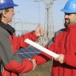 Engineer in a solar panel station — Stock fotografie