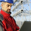 Engineers with laptop in industrial site — Stock Photo #5255364