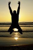 Man jumping at sunset — Stock Photo