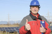 Engineer in a solar panel station — Stok fotoğraf
