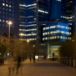 Night street in the middle of the modern city with skyscrapers — Stock Photo