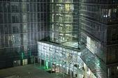 Entrance of Illuminated business building — Stock Photo