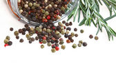 Color peppercorns in glass jar — Stock Photo