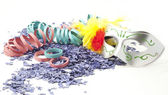 Carnival mask, confetti and streamers . — Stock Photo