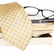 Pen, lens, pile of books and tie — Stock Photo