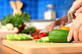Female chopping food ingredients. — Stock Photo
