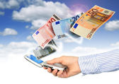 Mobile phone and euro money. — Stock Photo