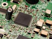 Microchip on a circuit board — 图库照片