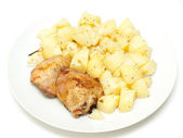 Roast chicken with potatoes — Stock Photo