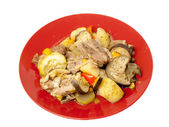 Turkey steaks with vegetables, potatoes and spices on a plate — Stock Photo