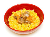 Goulash with conchigliette in a red bowl — Stock Photo