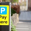 'Pay here' sign parking ticket vending machine — Stock Photo #5322608