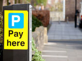 'Pay here' sign parking ticket vending machine — Stock Photo