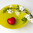 Stock Photo: Plum branch and heart on plate