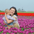 In Tulip Field. Mother with son in tulips field — Stock Photo