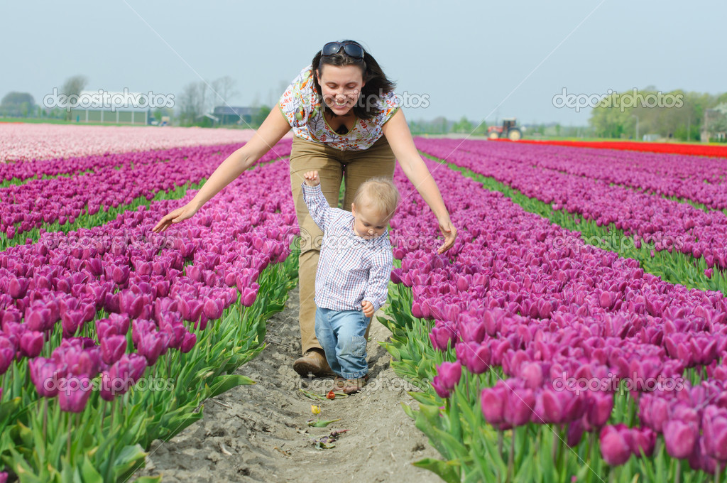 Mother with son in the purple tulips field  Stock Photo #5282845