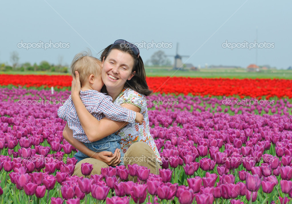Mother with son in the purple tulips field  Stock Photo #5283011