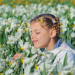 Stock Photo: Girl And Daffodils