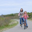 Mother with children on their bikes — Stock Photo