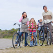 A family with children on their bikes — Stock Photo