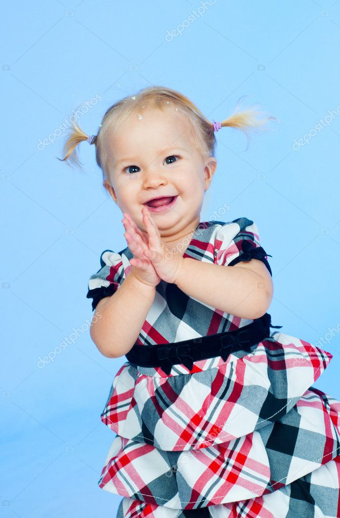 Cute baby girl in black pink and white stylish outfit in studio  Stock Photo #5304689