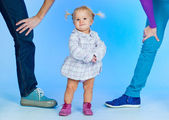 Cute baby Girl In Fashionable Outfit with parents — Stock Photo