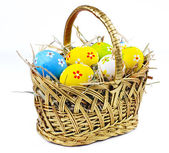Closeup basket with colorful Easter Eggs — Stock Photo