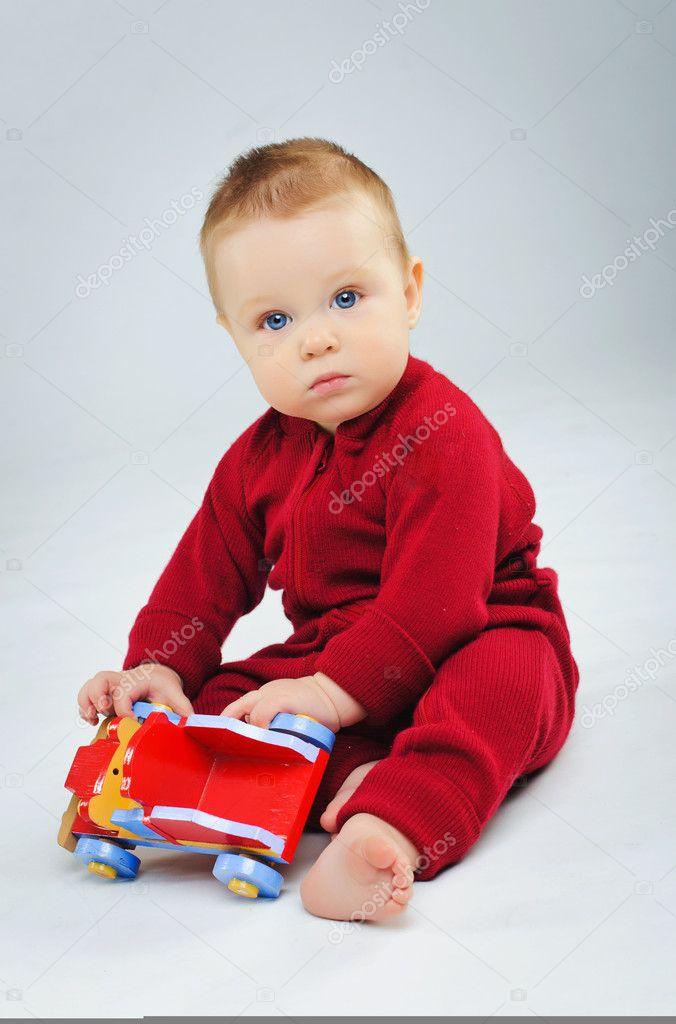 Baby Boy Toy Cars : Baby boy plaing his toy car — stock photo mac sim
