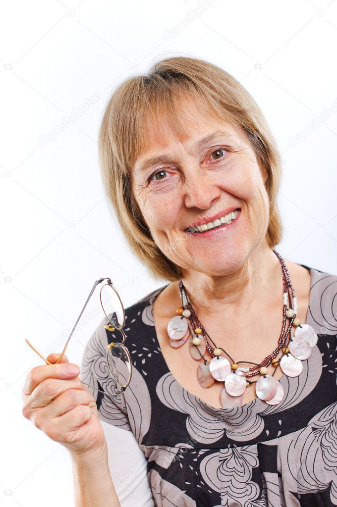 Portrait of a happy aged woman smiling  Stock Photo #5352355