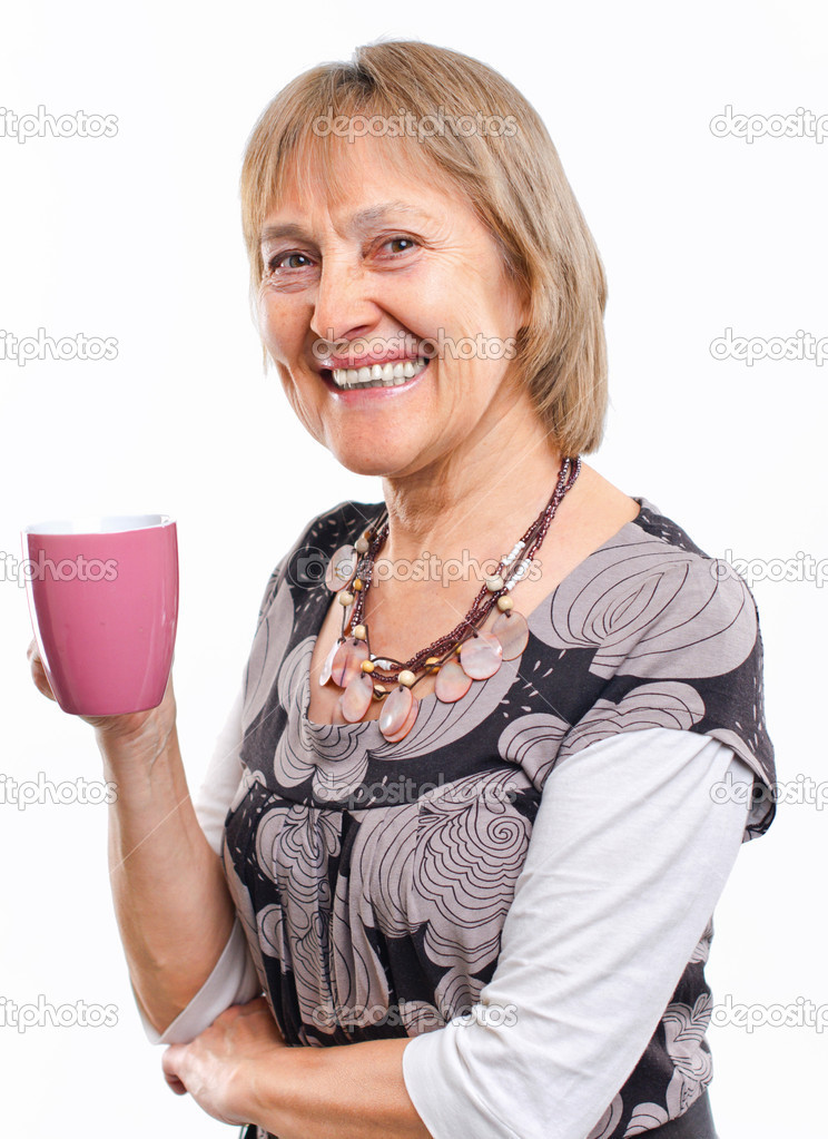 Portrait of a happy aged woman smiling with cup — Stock Photo #5357065